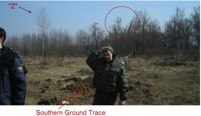 "The tree marked ""Z"" growing in the direct vicinity of the flight path, when the plane is flying from the Kutuzov Street (red circle) to the place of crash. The ground trace from the tail is visible and marked here as ""Southern Ground Trace""."